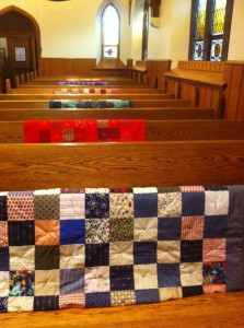 Lap Quilts hung over the pews for Veteran's Day.